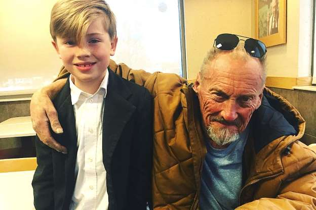 A boy asked his dad to help the homeless. Now, father and son take them out to lunch each week.